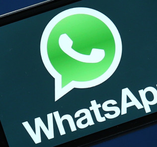 SAN FRANCISCO, CA - FEBRUARY 19:  Facebook and WhatsApp logos are displayed on portable electronic devices on February 19, 2014 in San Francisco City. Facebook Inc. announced that it will purchase smartphone-messaging app company WhatsApp Inc. for $19 billion in cash and stock.  (Photo Illustration by Justin Sullivan/Getty Images)